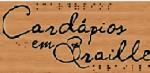 FOTO: A foto é com um fundo da cor marrom - semelhante a madeira. Ao centro o  texto escrito é